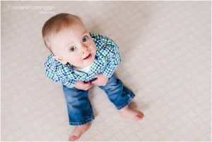 Baby looking up on carpet
