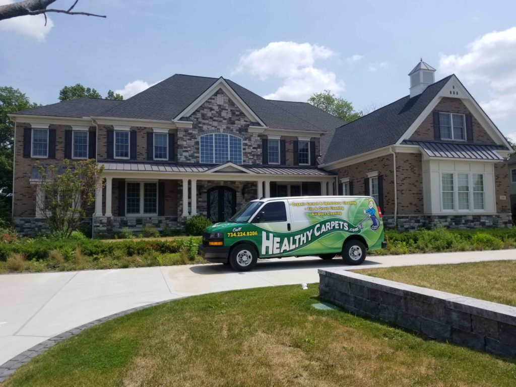 Healthy Carpets van in front of clients home in Ann Arbor michigan